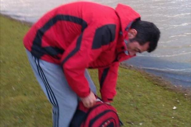 Hasan Fidan stuffs royal swan in to a bag to enjoy later in scenes caught on camera in Kent
