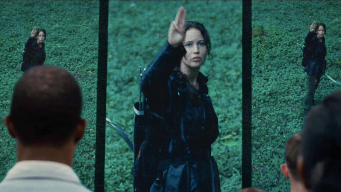 katniss three fingers salute hunger games