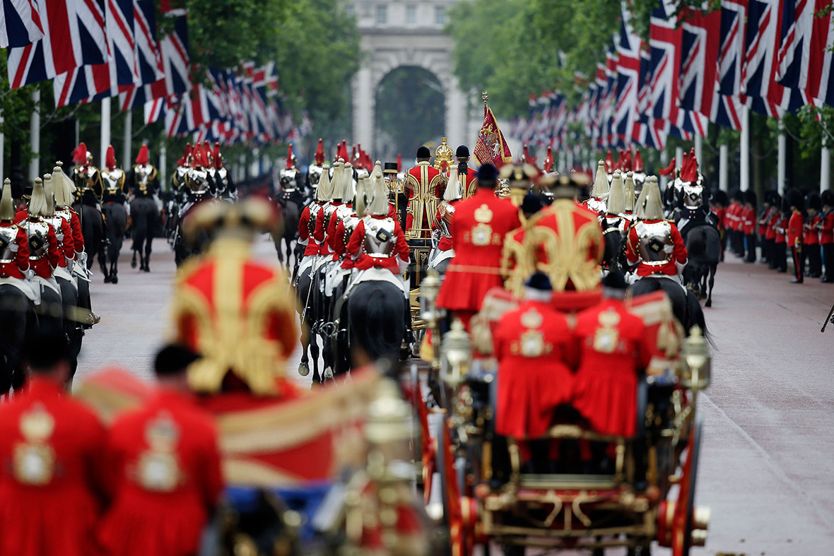A military procession escorts the carriage of Queen Elizabeth II as it processes down the Mall