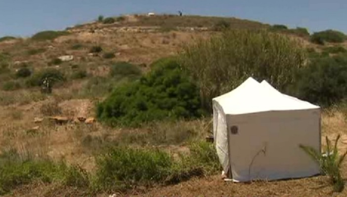 Police erect tent on scrub land in the search for Madeleine McCann