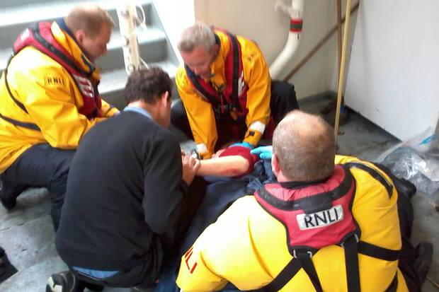 RNLI rescuers treat victim after boat hit Tower Bridge