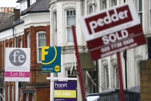 Britain's housing market shirks off banks trying to curb mortgage lending