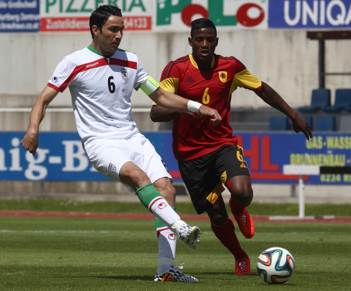 Iran's Javad Nekounam (L) challenges Angola's Joaquim Adao during a friendly soccer match in Hartberg May 30, 2014.