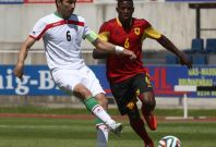 Iran\'s Javad Nekounam (L) challenges Angola\'s Joaquim Adao during a friendly soccer match in Hartberg May 30, 2014.