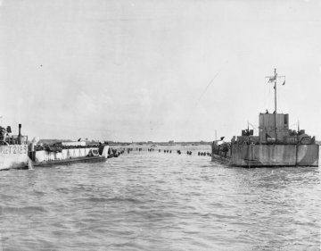 The Royal Navy during the Second World War LCT 2189 supported by a LCG (Landing Craft (Gun)) discharges Allied troops onto the Normandy beaches during D Day.
