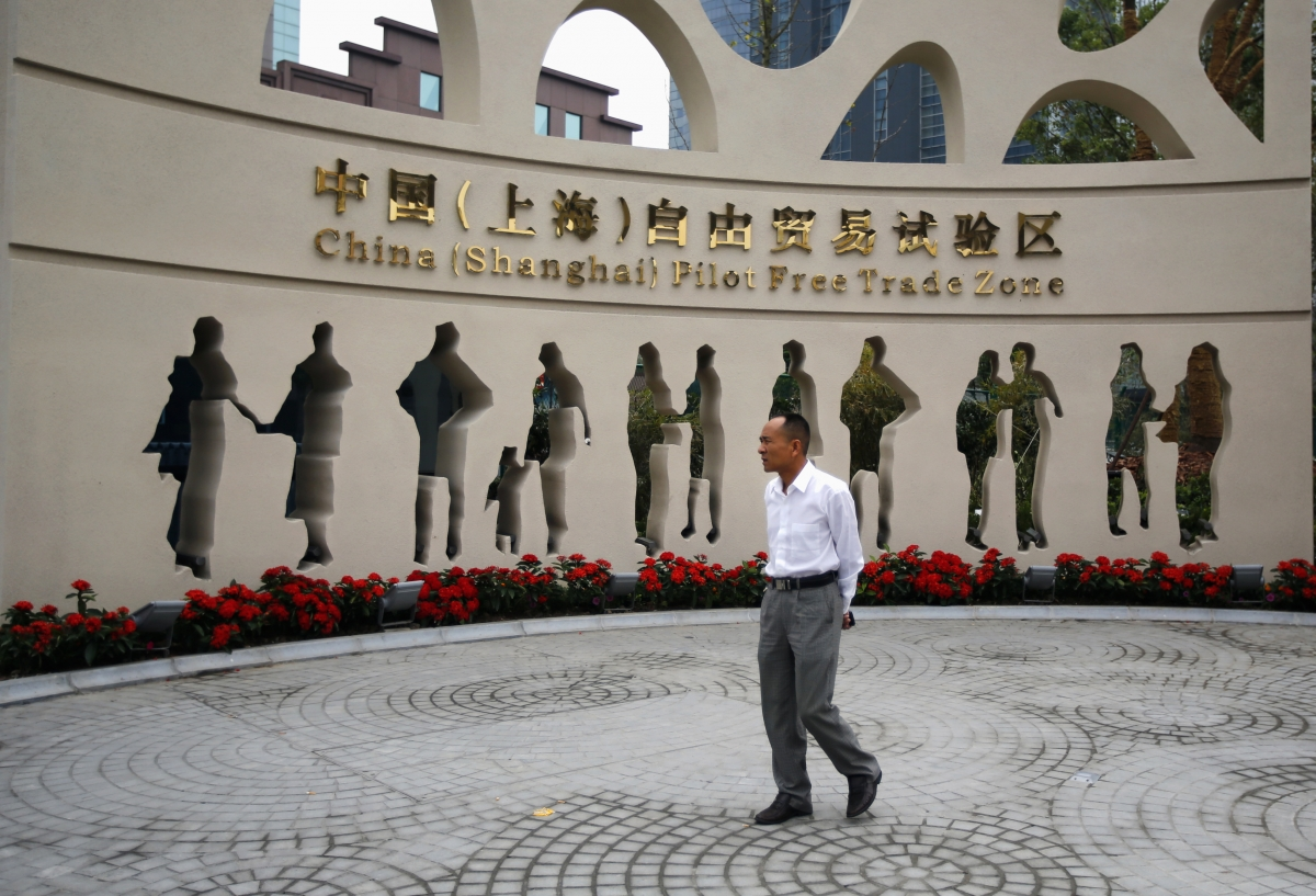 A man walks at the entrance of the new Shanghai Free Trade Zone in Pudong district, Shanghai
