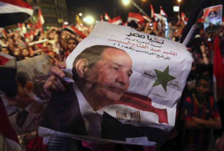 Egyptians gather outside the presidential palace to celebrate former Egyptian army chief Abdel Fattah al-Sisi's victory in the presidential vote in Cairo