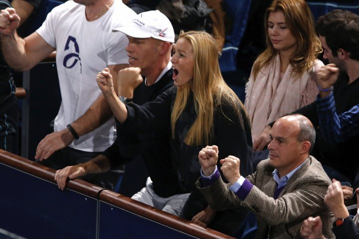 Jelena Ristic (C), fiancee of Novak Djokovic of Serbia, cheers during the final match of the Paris Masters men's singles tennis tournament between Djokovic and David Ferrer of Spain at the Palais Omnisports of Bercy in Paris