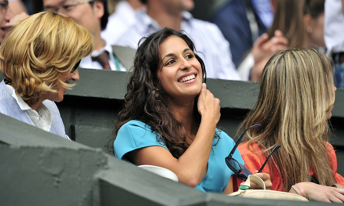 Rafael Nadal's mother Ana Maria Parera (L) and girlfriend Maria Francisca Perello, 'Xisca' and sister Maria Isabel Nadal smile during the men's single final between Spanish player Rafael Nadal and Serbian player Novak Djokovic at the Wimbledon Tennis