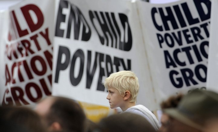 Demonstrators listen to speakers at a child poverty rally in Trafalgar Square, London