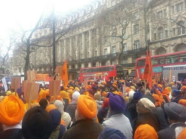Scores of Sikh demonstrators marching through central London.