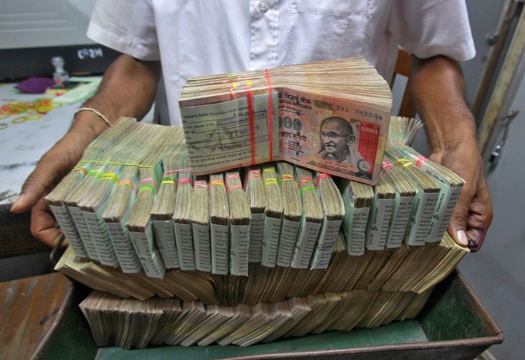 Asia EM-FX: Rupee off lows on RBI, Thai baht falls to 1