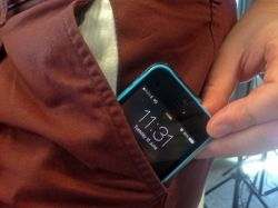 An iPhone 5C smartphone in a pocket