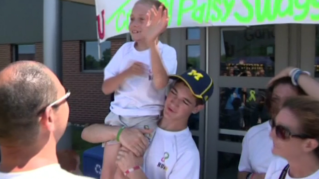 Michigan Teen Carries His Brother 40 Miles in Aid of Cerebral Palsy
