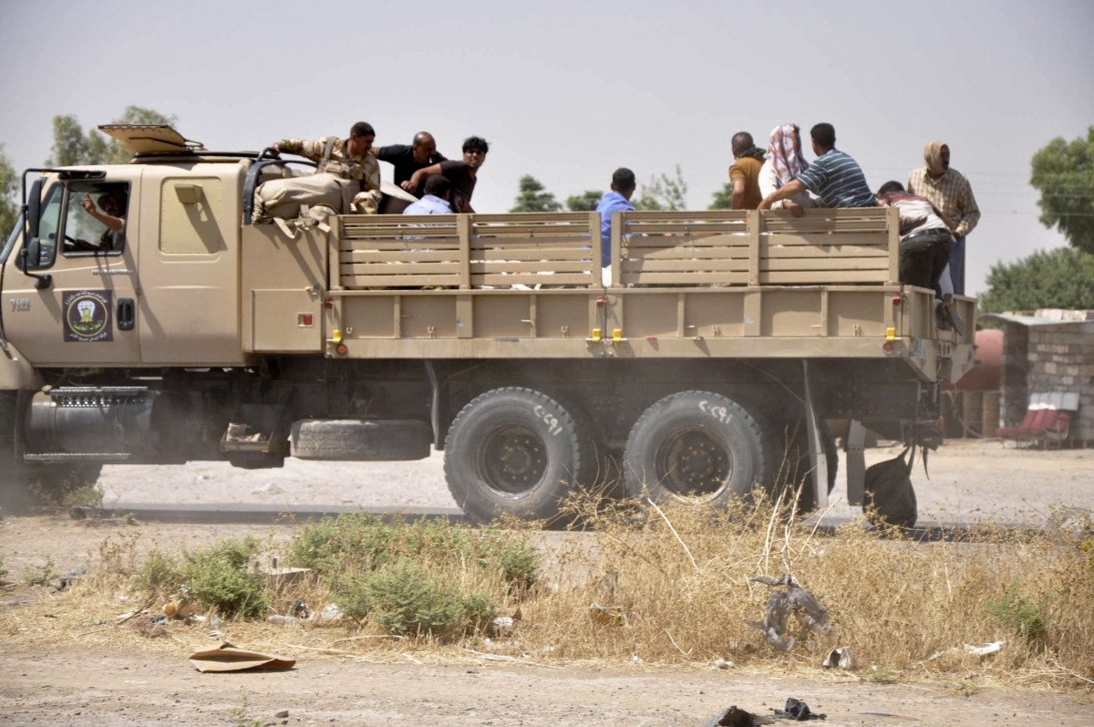 Iraqi security forces leave a military base as Kurdish forces take over control in Kirkuk