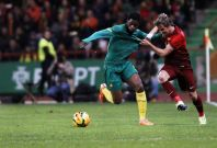 Portugal\'s Fabio Coentrao (R) fights for the ball with the Cameroon\'s Alex Song during their international friendly soccer match at Leiria stadium March 5, 2014.