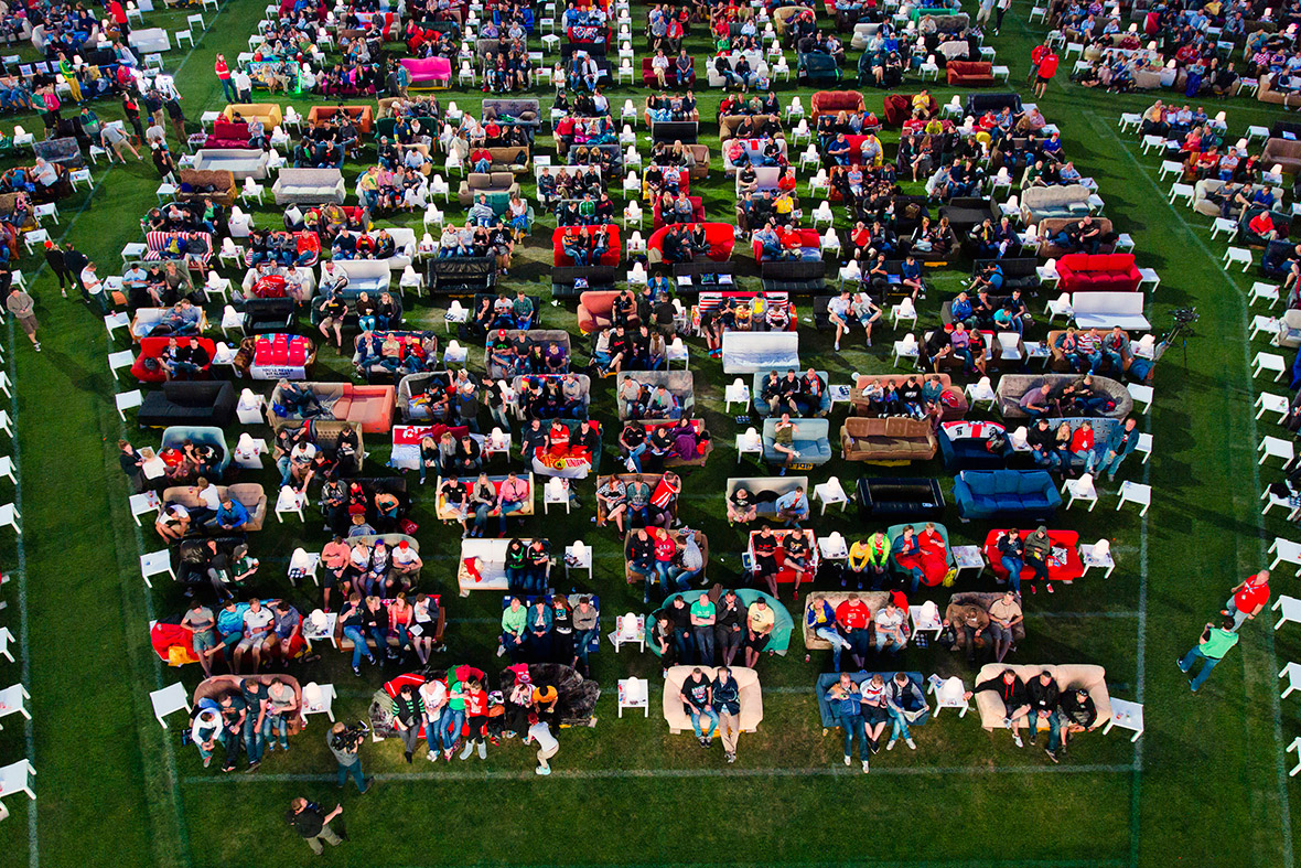 People Sitting On Sofas Watch The Opening Game Of 2014 World Cup At Alte Foersterei Stadium In Berlin