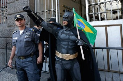 Batman gestures with a national flag at a protest on Brazils Independence Day in Rio, September 7, 2013