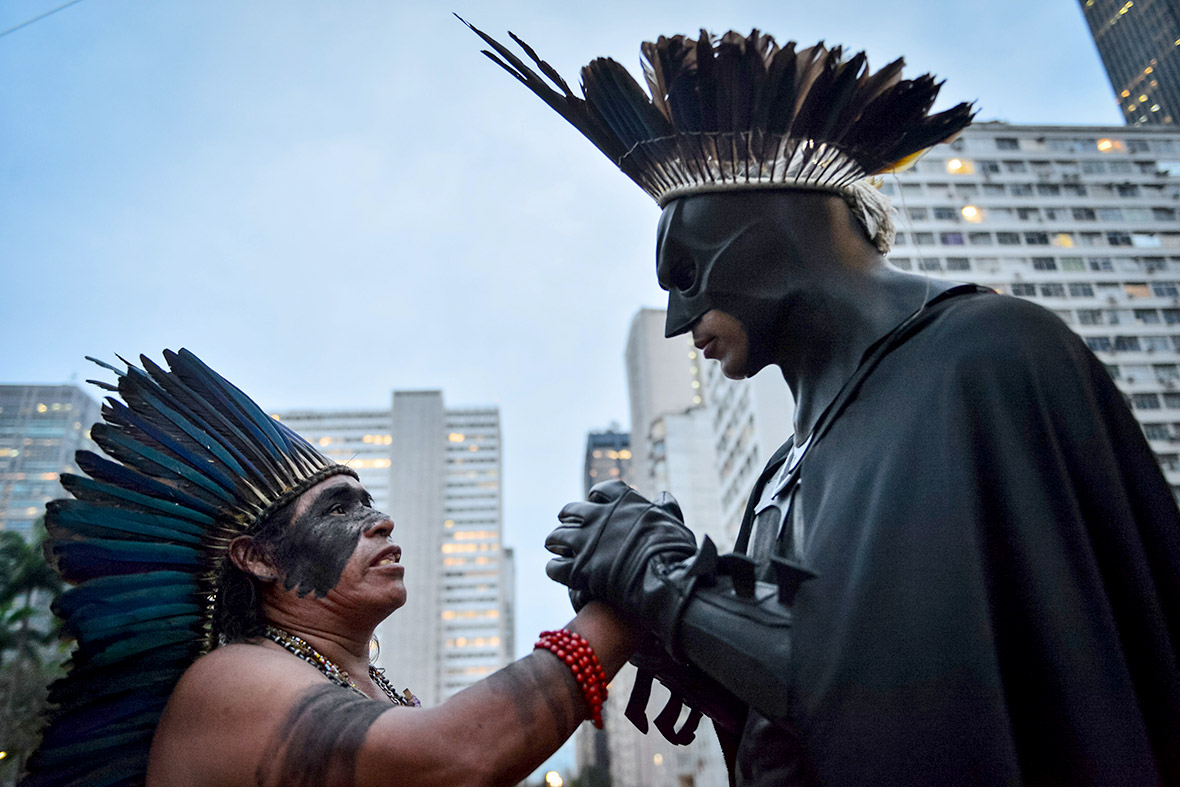 Indigenous leader Korobo speaks with Eron Morais de Melo, aka Batman, during a protest demanding more government support for Brazils indigenous people, on  October 4, 2013