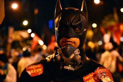 Batman marches during a teachers protest demanding better working conditions, on October 7, 2013