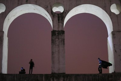 Batman watches over Rio from the Carioca Aqueduct on October 31, 2013