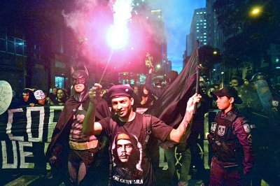 The Superhero joins forces with Latin American hero Ernesto Che Guevara during a Guy Fawkes Day protest in Rio on November 5, 2013