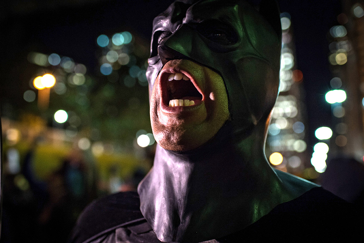 Batman shouts during a protest by anarchist group Black Bloc against the World Cup on May 30, 2014