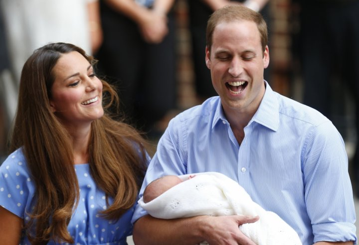 Prince William and Kate Middleton appear with Prince George, outside the Lindo Wing of St Mary's Hospital, in central London July 23, 2013.