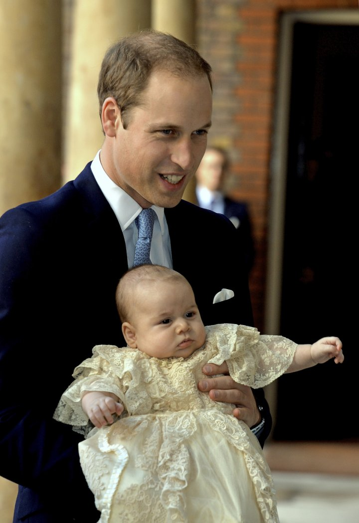Prince William carries Prince George as they arrive for his son's christening at St James's Palace in London October 23, 2013.