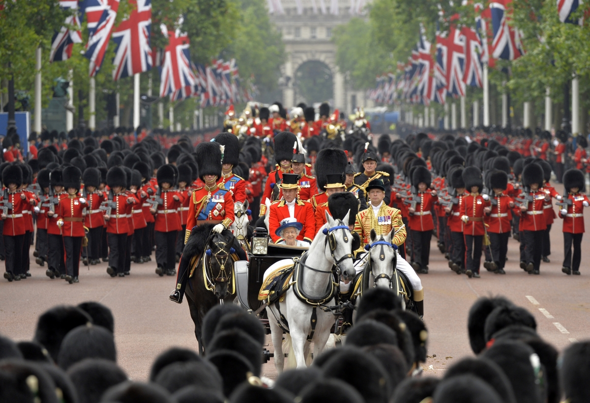 The Queen rides down The Mall as she returns to Buckingham Palace in the annual Trooping the Colour ceremony