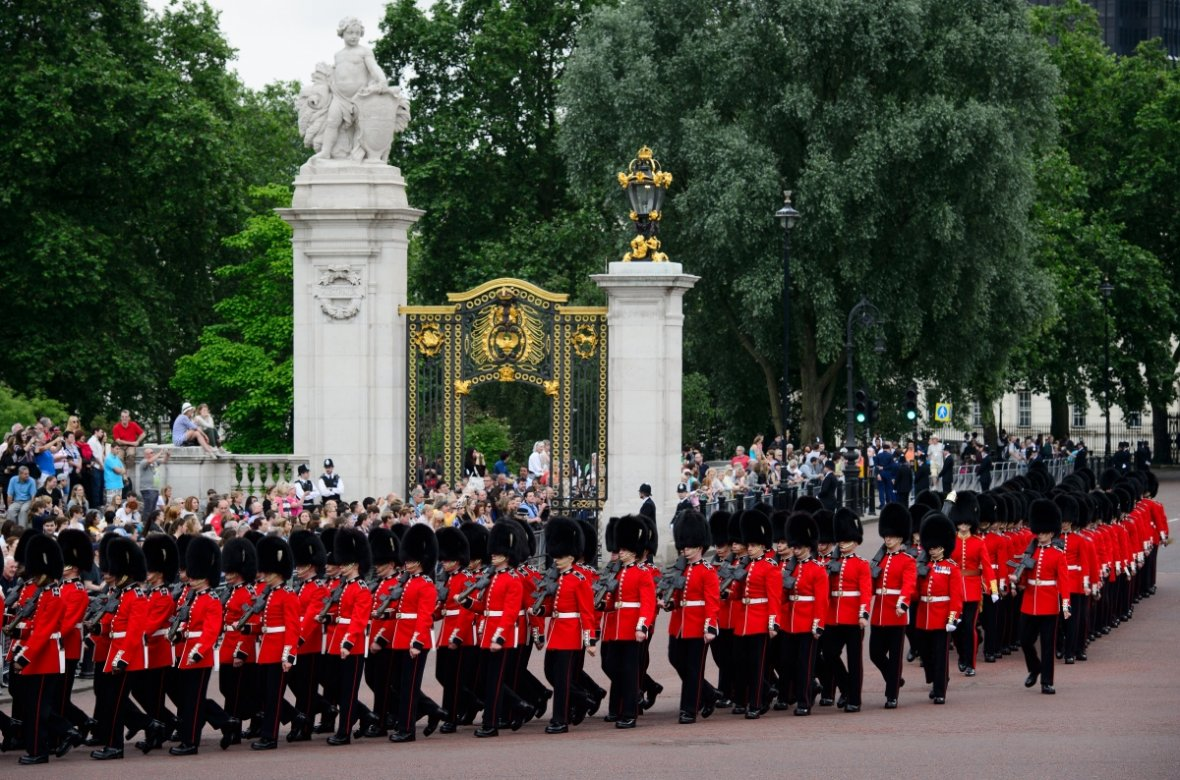 Members of the Queens Guard march past Buckingham Palace ahead of Trooping the Colour (Getty)