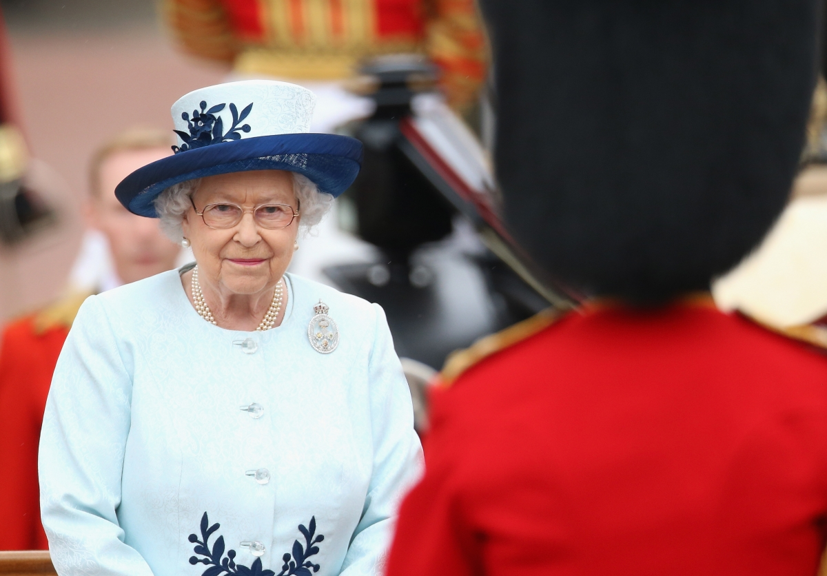 The Queen takes a salute during the Trooping of the Colour (Getty)
