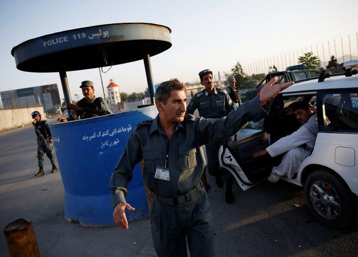 Police manning a security checkpoint in Kabul