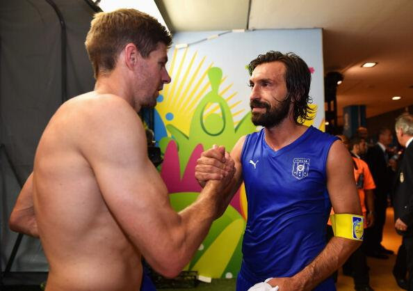 England captain Steven gerrard and Itaky's Andrea Pirlo swap shirts after the match. (@LFCPhoto)