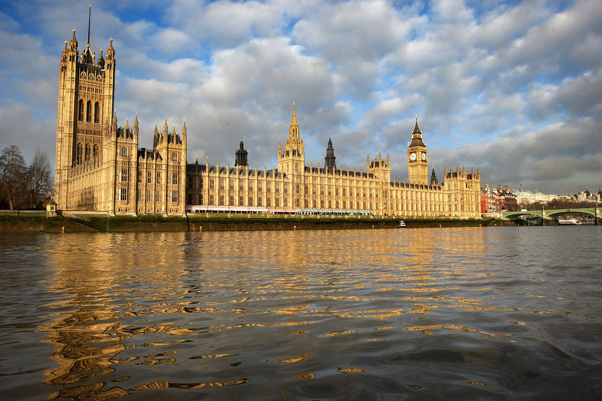 the Houses of Parliament on the banks of the River Thames