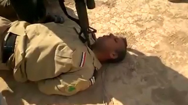 Iraqi Prisoners Questioned, One Dead