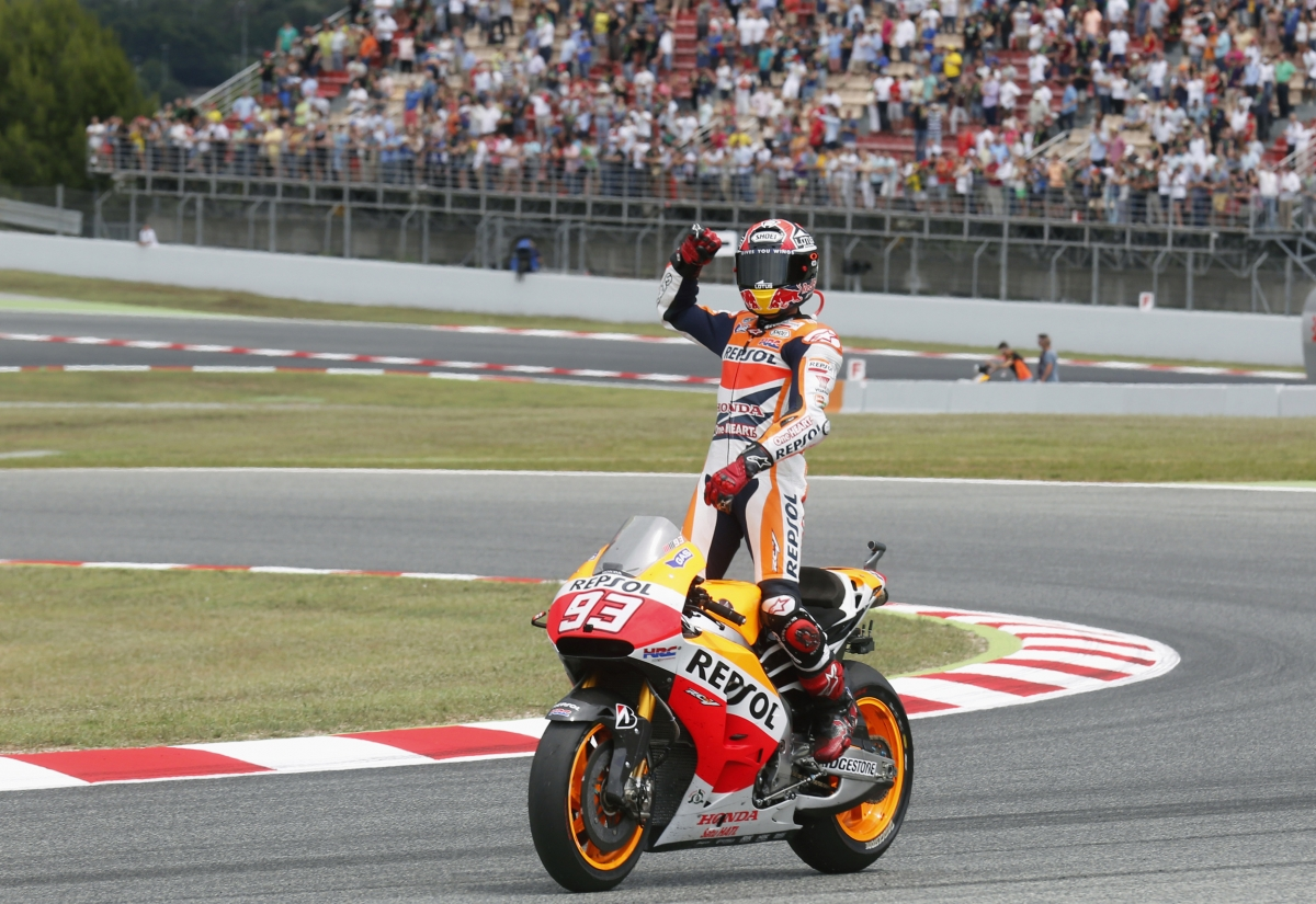 Honda MotoGP rider Marc Marquez of Spain celebrates his victory of the Catalunya Grand Prix in Montmelo, near Barcelona June 15, 2014.