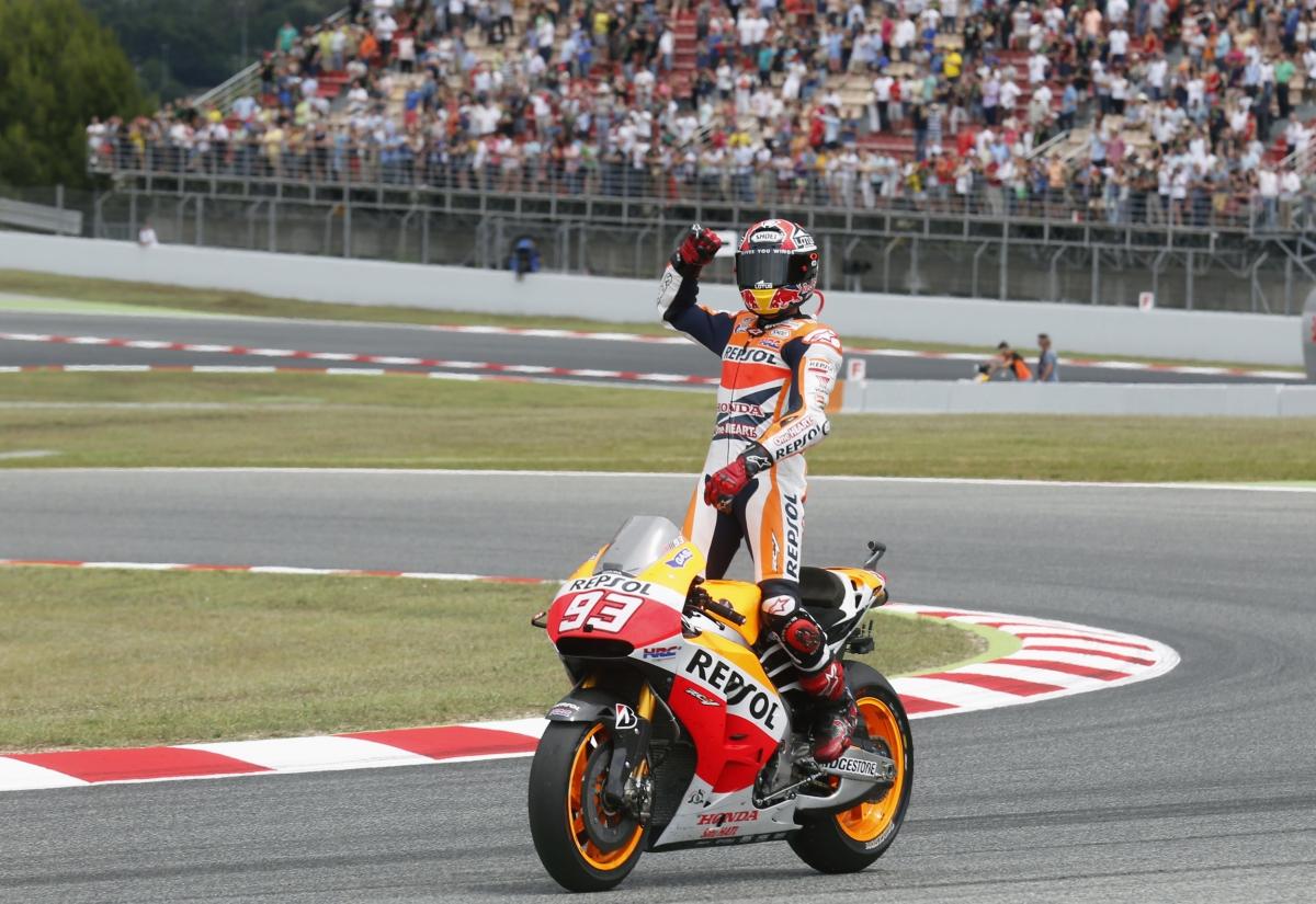 Honda MotoGP rider Marc Marquez of Spain celebrates his victory of the Catalunya Grand Prix in Montmelo, near Barcelona June 15, 2014.