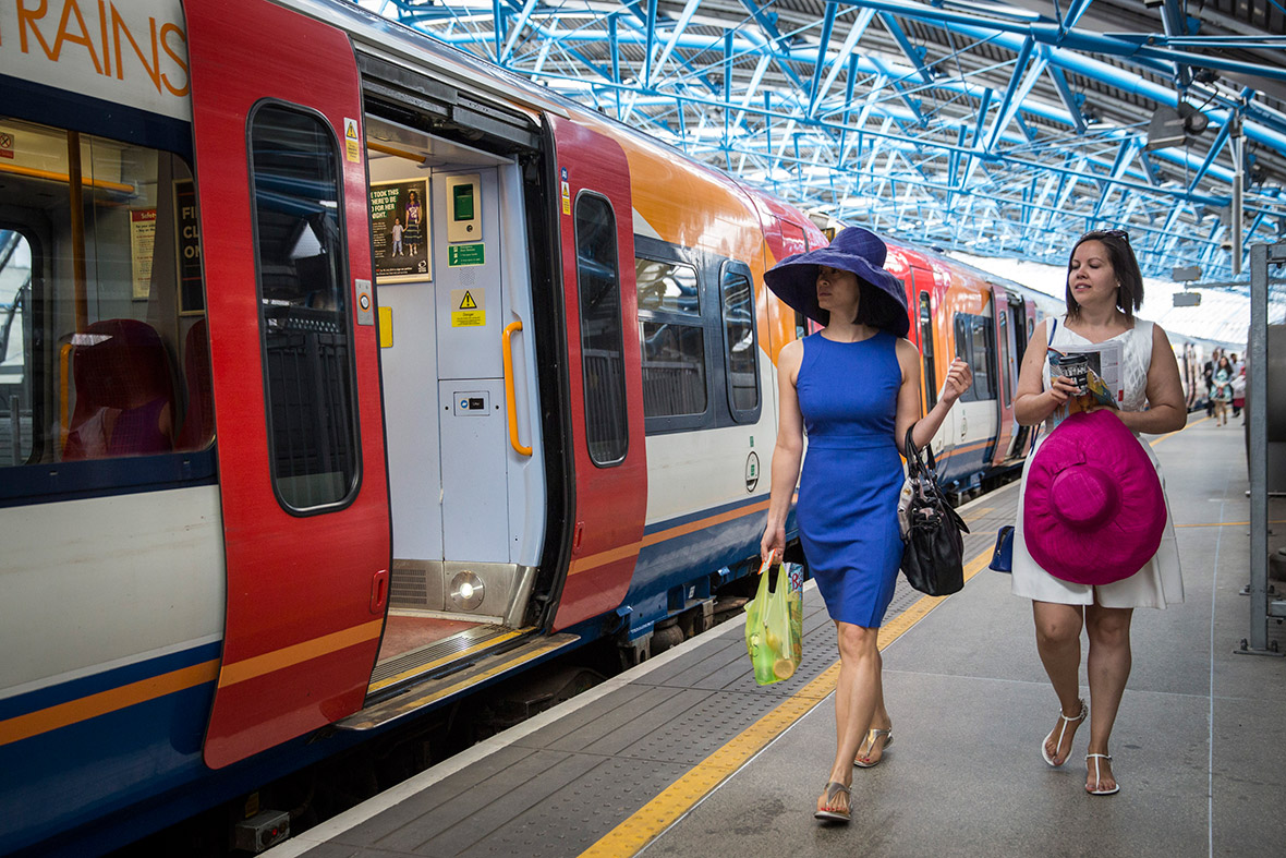 Racegoers travel by train from Waterloo station to Ascot racecourse `