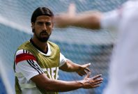 Germany\'s Sami Khedira stretches during a training session at the Arena Fonte Nova stadium ahead of their 2014 World Cup against Portugal in Salvador, June 15, 2014