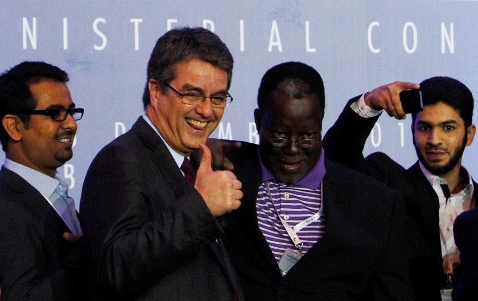 Director-General Roberto Azevedo gives a thumbs-up as he greets delegates after the closing ceremony of the ninth World Trade Organization (WTO) Ministerial Conference in Nusa Dua, on the Indonesian resort island of Bali, on 7 December, 2013 (Reuters).
