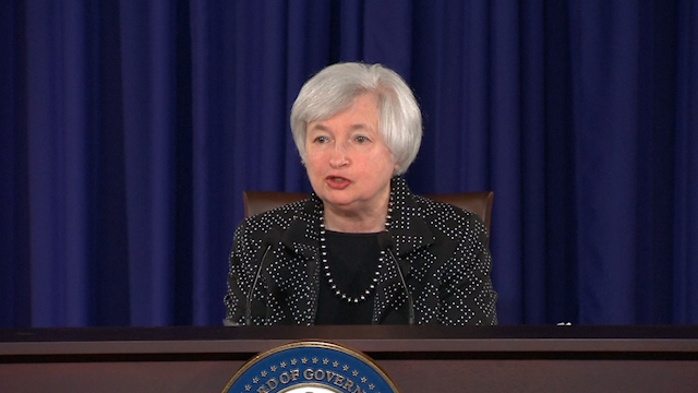 US Fed Cuts 2014 Growth Outlook, Goes Ahead with Tapering