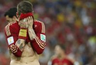 Spain\'s Sergio Ramos reacts during their 2014 World Cup Group B soccer match against Chile at the Maracana stadium in Rio de Janeiro June 18, 2014