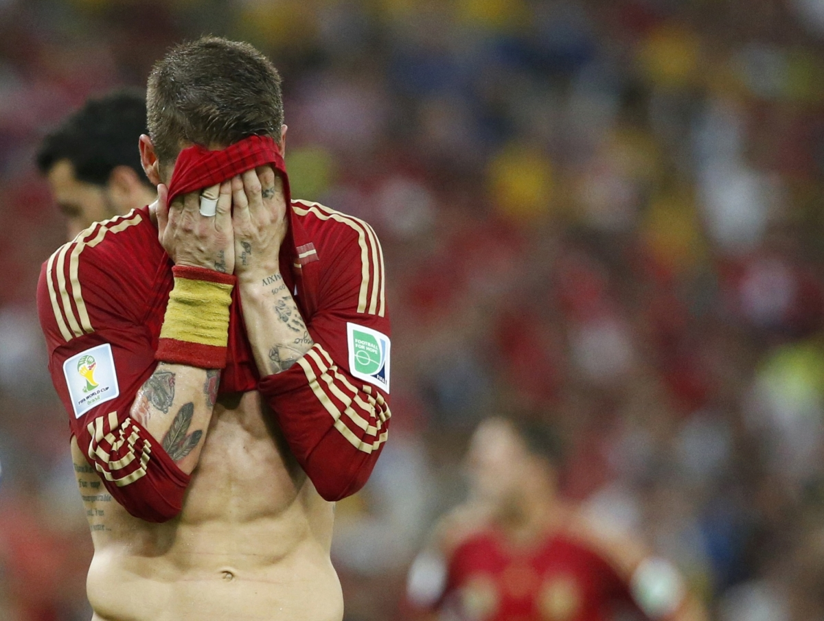 Spain's Sergio Ramos reacts during their 2014 World Cup Group B soccer match against Chile at the Maracana stadium in Rio de Janeiro June 18, 2014