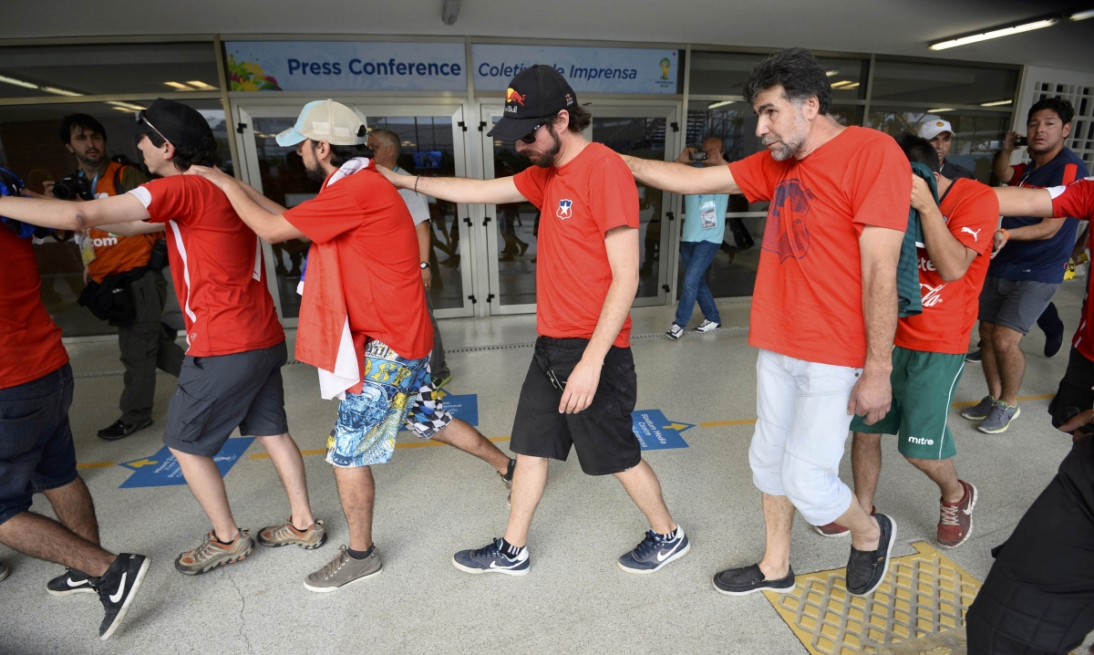 Dozens of Chilean Fans Arrested after Maracana Media Centre Storming