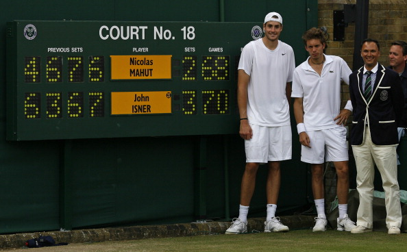 John Isner of the US (L), France's Nicolas Mahut