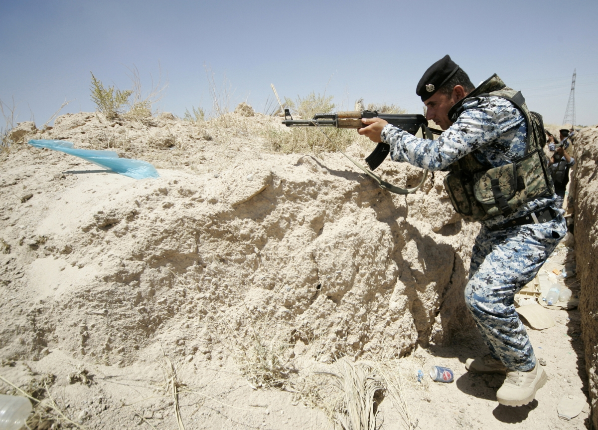 A member of the Iraqi security forces takes position during a patrol looking for militants of the Islamic State of Iraq and the Levant (ISIL) at the border between Iraq and Saudi Arabia