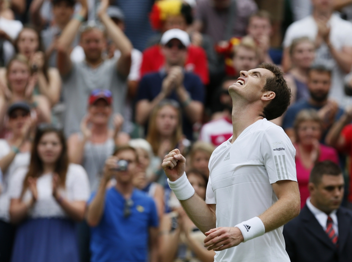 Andy Murray of Britain reacts after defeating David Goffin of Belgium in their men's singles tennis match at the Wimbledon Tennis Championships, in London June 23, 2014