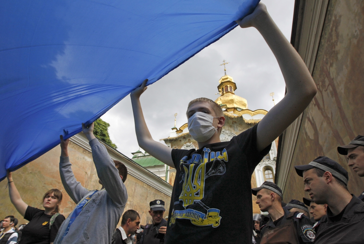 People take part in a pro-Ukrainian anti-separatist rally near Kiev