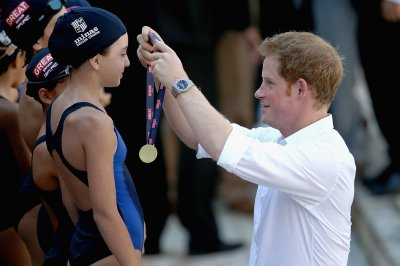 Prince Harry presents medals to young swimmers